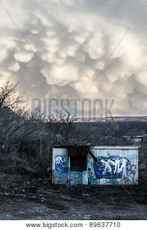 Vandalized Metal Shack And Strange Unusual Cloud Formations
