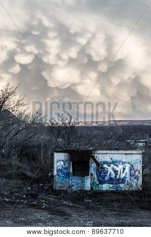 Vandalized Metal Shack And Strange Unusual Cloud Formations
