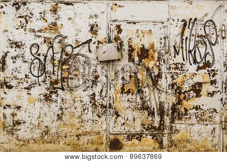 Rust On Grey Metal With Urban Vandal Art
