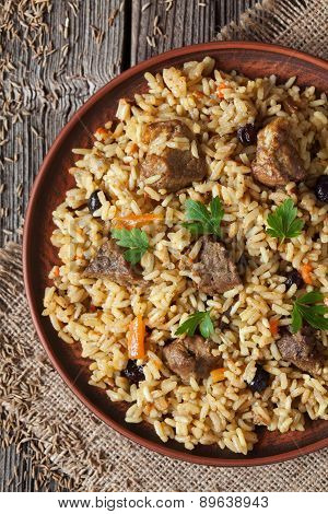 Arabic cuisine national rice food called pilaf with fried lamb meat, onion, carrot and garlic spice