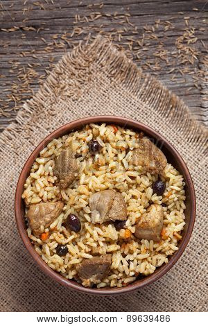 Spicy traditional arabic national rice food pilaf cooked with fried meat, onion, carrot and garlic i