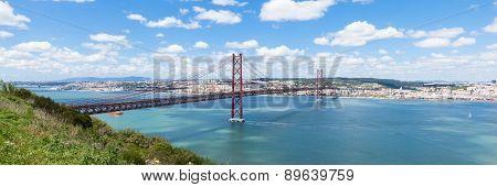 Panoramic View Of 25 De Abril (april) Bridge In Lisbon - Portugal