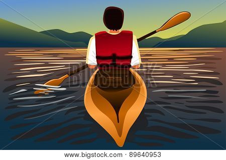 Man Riding A Kayak In The Lake