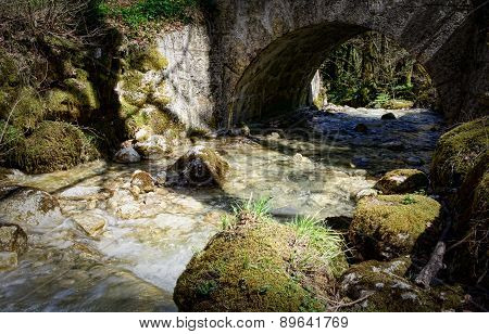 A Small Stream Under A Stone Bridge