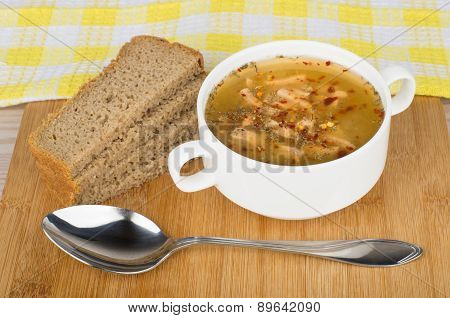 Pea Soup With Bread And Spoon On Wooden Board