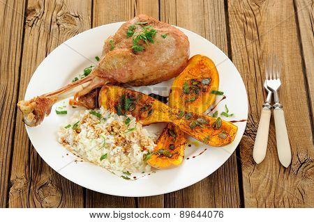 Roasted Turkey Leg With Butternut Squash, Pumpkin Seeds And Rice And Two Forks
