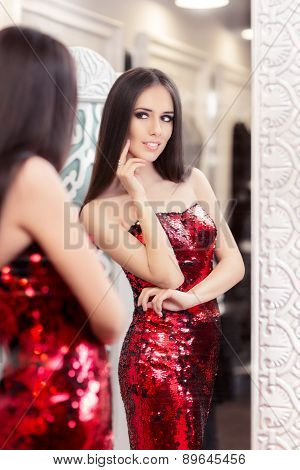 Beautiful Girl in Red Sequin Dress Looking in the Mirror