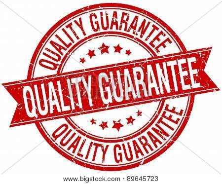 Quality Guarantee Grunge Retro Red Isolated Ribbon Stamp