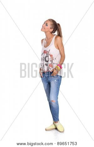 Young woman standing full length isolated on white background.