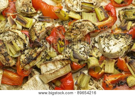 Vegetables mix baked in the oven with aubergine, red bell pepper, leek, basil and olive oil.