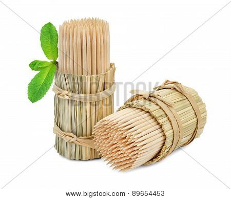 Toothpicks in packs of straw and a mint.