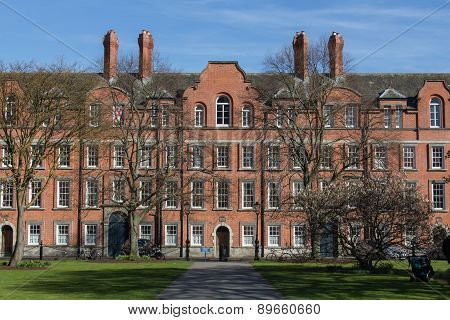 Dublin, Ireland - March 22, 2015: The Rubrics is the oldest building within the University of Dublin view from the Library Square