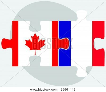Canada And France Flags In Puzzle