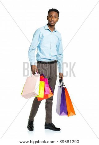 African American Man Holding Shopping Bags On White. Holidays Concept