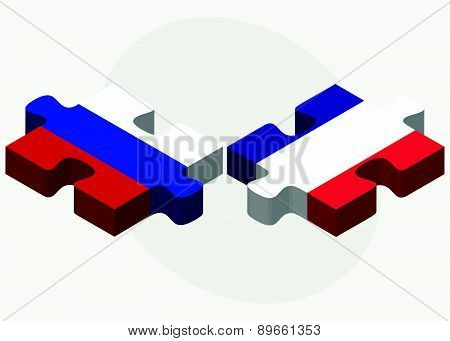 Russian Federation And France Flags In Puzzle