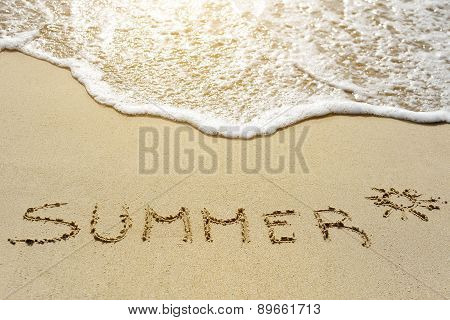 Summer Word Written On The Sand Beach