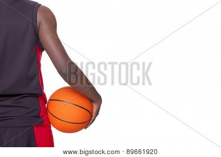 Back view of a basketball player holding a ball, isolated on white background