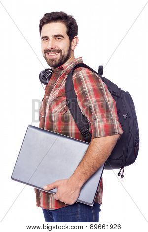 Happy smiling student holding a laptop, isolated on white background
