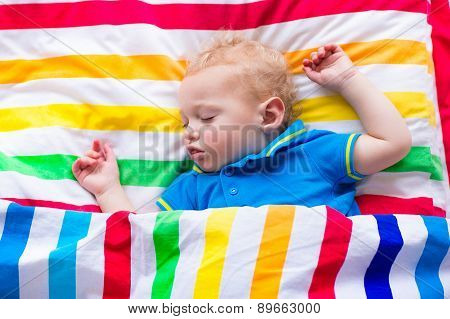 Little Baby Boy Sleeping In Bed