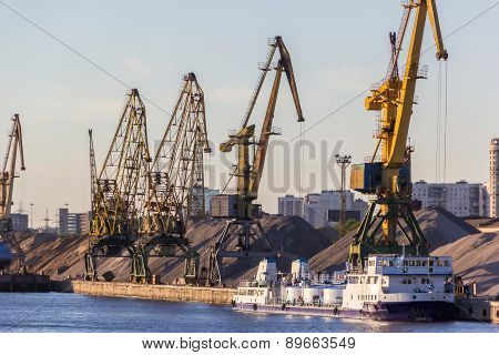 Barges And Cranes In River Port