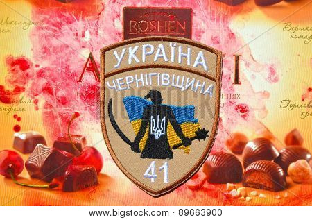 Chevron of Ukrainian nationalist formations. With logo Roshen Inc. Trademark Roshen is property of ukrainian president Poroshenko.on April 16,2015 in Kiev, Ukraine