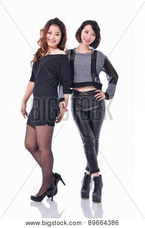 Two fashion women posing in studio