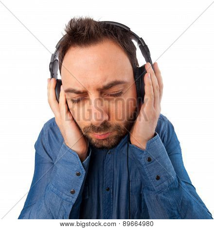 Mman While Listening To Music Withl Headphones
