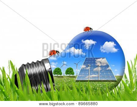 Solar panels and wind turbines in light bulb. Green energy concept.