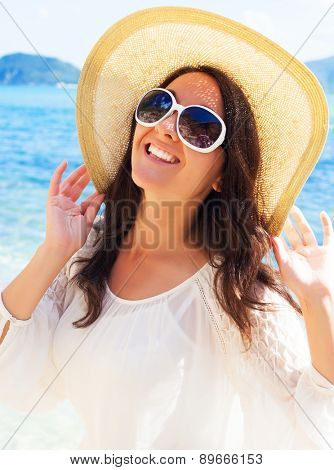 travel concept - Happy woman in hat on the beach