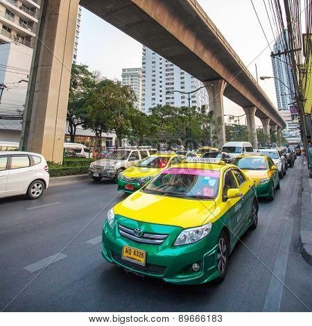 BANGKOK, THAILAND - FEBRUARY 7, 2015: colorful cars taxi in Bangkok on February 7, 2015. In Bangkok taxi is not expensive and popular means of transport in the city.