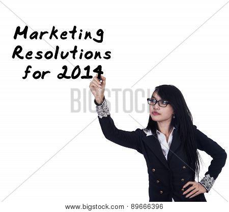 Businesswoman Writes Marketing Resolutions