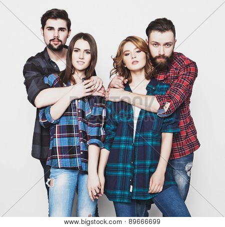 life style, happiness and people concept: attractive group of happy young men and women. Hipster style. Studio shot over white background. Special Fashionable toning.