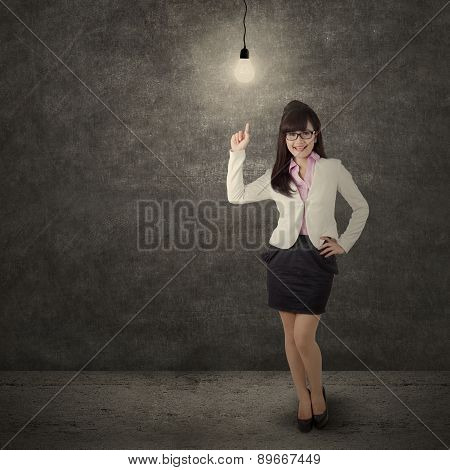 Female Entrepreneur Pointing At Lightbulb
