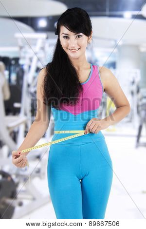 Female Fitness Trainer At Gym Center