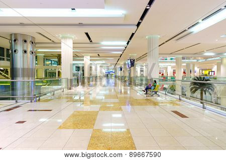 DUBAI, UAE - OCT 16: airport interior on October 16, 2014 in Dubai. Dubai International Airport is an international airport serving Dubai. It is a major airline hub in the Middle East