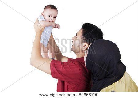 Happy Parents With Baby Boy In Studio