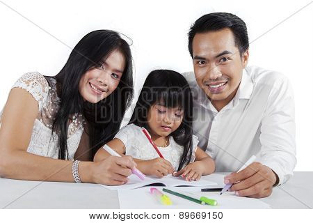 Little Girl Studying With Her Parents