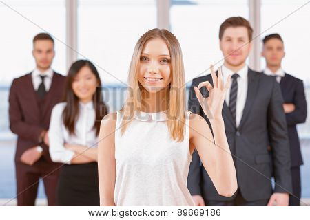 One of businesswoman or businessman standing in the foreground a