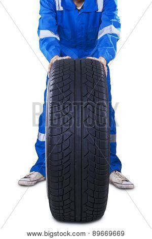 Male Mechanic Changing A Tire