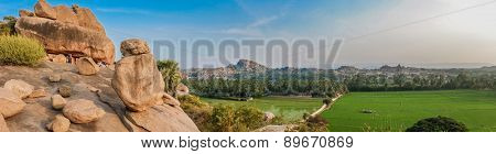 Hilltop view of Hampi's boulder strewn landscape and rice paddies