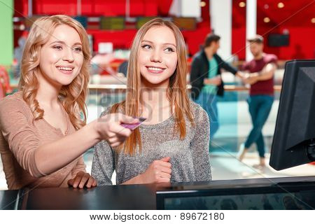 Pair of women choosing entertainment