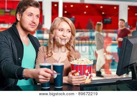 Couple buying popcorn and coke