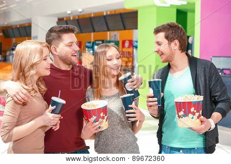 People waiting for movie with snacks