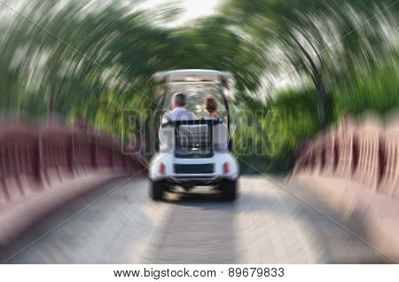 Couple in car going over bridge, blurred image.