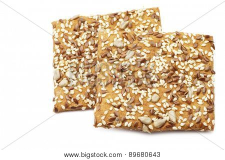 crispy spelt crackers with mixed seeds on a white background