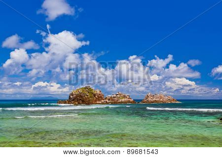 Stones in ocean at Seychelles - nature background