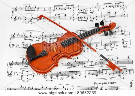Toy violin and music sheet - art musical background