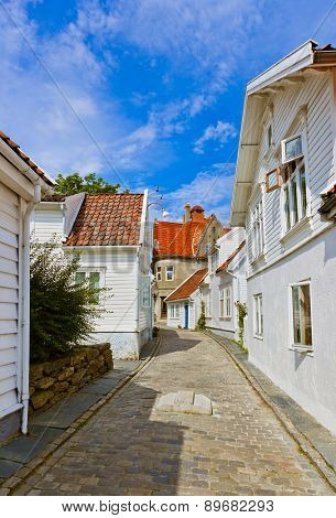 Street with white wooden houses in old centre of Stavanger - Norway - architecture background