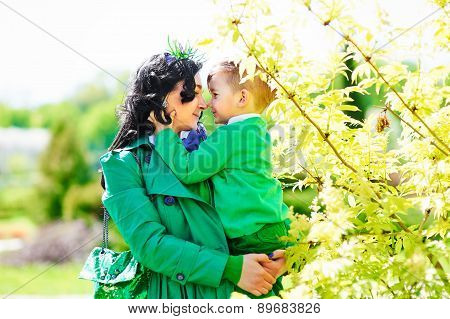 modern stylish happy mother holding little son