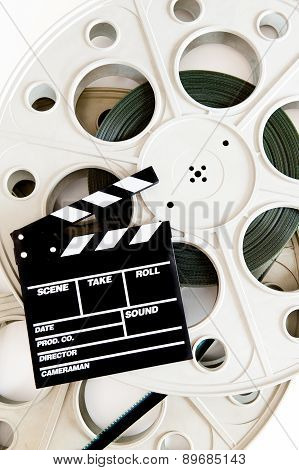 Movie Clapper On Two 35 Mm Cinema Reels With Film Vertical